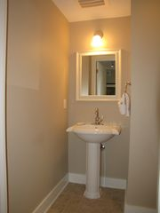 Fort Walton Beach condo photo - Half bath with sink and toilet.