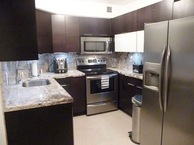 Beautiful kitchen with granite tops! Stainless steel sink and appliances!