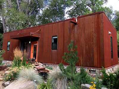 Taos Rio Eco Dwelling with corten steel and river rock stone- pond in front