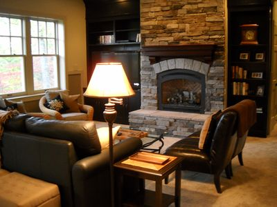 Sunny lower level family room with gas fireplace.