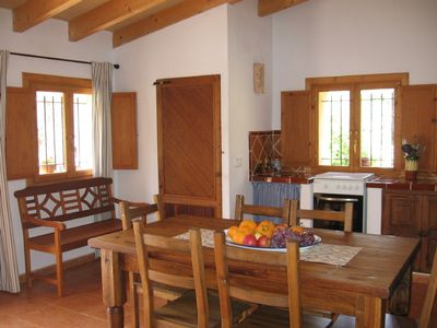 The rustic and sunny dinning room and kitchen area