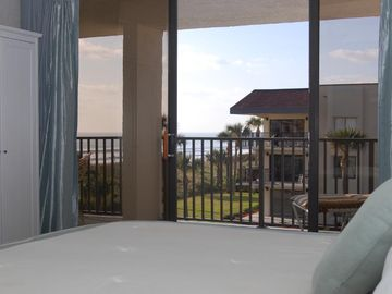 See and hear the ocean from the king size bed. You can wake up to this view
