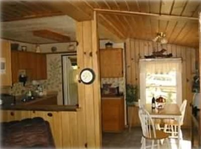 Knotty pine living room and fully equipped sunny kitchen