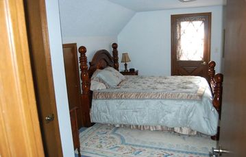 Upstairs bedroom with queen bed, small deck and sounds of the river