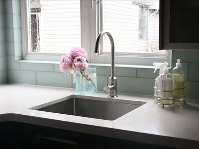 Kitchen sink with views of downtown Vancouver.