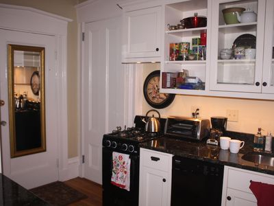Kitchen. Door to left of stove is a large closet. Gas stove