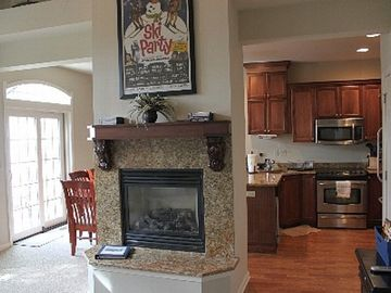 Family room with gas fireplace and fully stocked kitchen