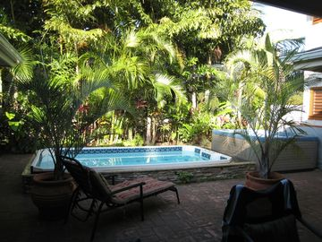 Private garden lanai boasts pool and hot tub