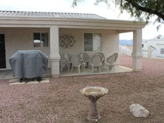 Lake Havasu City house photo - Back patio and yard with bird bath