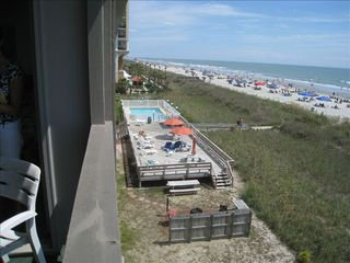 Ocean Drive Beach condo photo - View of pool, sun deck and grilling area from the balcony.