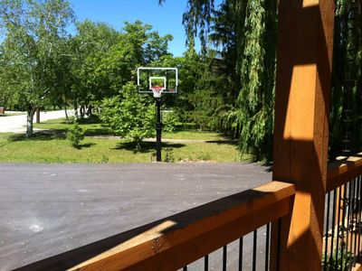 Pro basketball hoop, with large driveway.