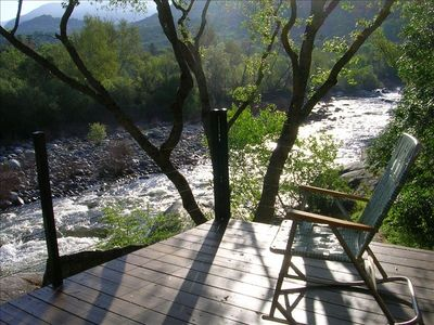 Picture yourself sitting here at sunrise or on a moonlit night looking up river
