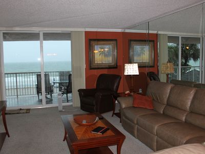 Family room with sliding glass doors onto oversized balcony w/view of the Gulf.