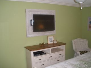 St. Simons Island condo photo - Private 32 inch TV with DVD player. All rooms have ceiling fans.