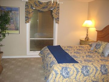 Master bedroom with king-size bed - view of harbor from bedroom window