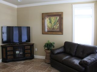 Crystal Beach house photo - Enjoy one of our 100+ movies on the 55 inch LCD