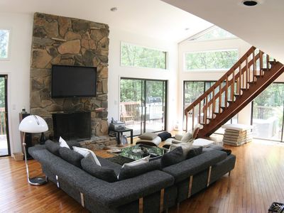 Great room with wood burning fireplace, 60' flatscreen and a lot of light