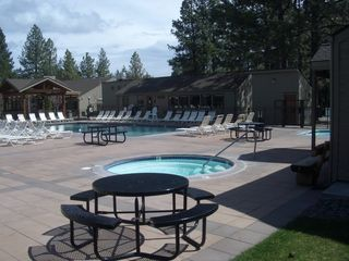 Bend condo photo - One hot tub, one pool behind