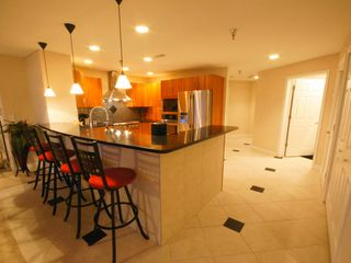 Osage Beach condo photo - The Chef's Kitchen is Fully-Equipped and Open to the Large Living Area