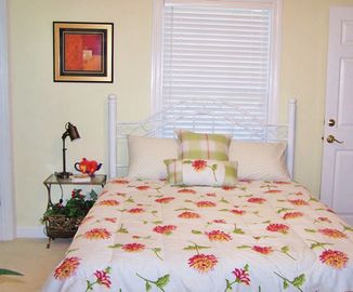 Bedroom #2 with queen bed and private bath.