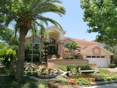 Our 5 bedroom 4.5 bathroom  waterfront home boasts dramatic landscaping.