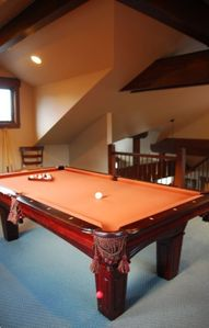 The Loft holds a regulation size pool table and private deck!
