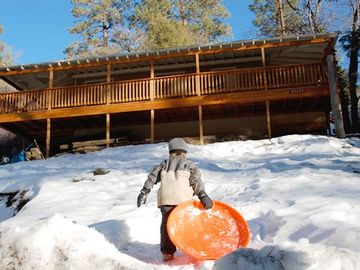 Moonridge cabin rental - Sledding in the front yard