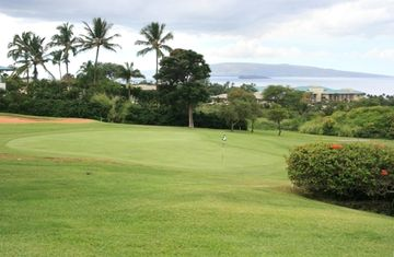 Wailea Ekolu Village overlooks the green fairways of the Old Blue Golf Course.