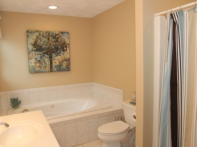 King bedroom bathroom with whirlpool tub and shower