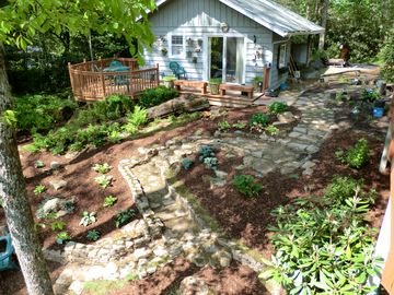 Our rock garden can also be seen from the deck. The carport is beyond.