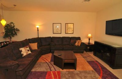 Huge Great Room With Sleeper Sectional and Lage Screen TV !
