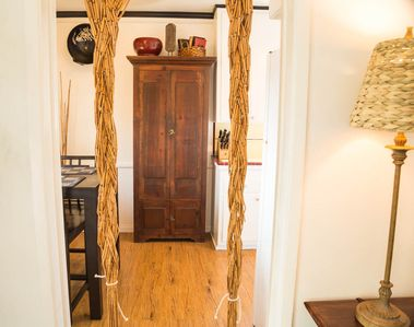 Beautiful entrance to the dining area and view of elegant armoire