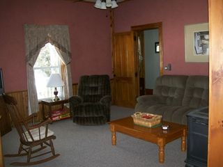 Jefferson farmhouse photo - Cozy den/living room with gas fireplace, TV, and table to play games.