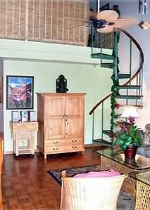 Spiral staircase leading to private loft bedroom. Lanai is at your back