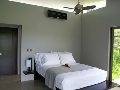 One of two guest bedrooms each with Queen bed, ceiling fan and air conditioning.