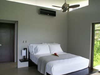 Nicoya house photo - One of two guest bedrooms each with Queen bed, ceiling fan and air conditioning.