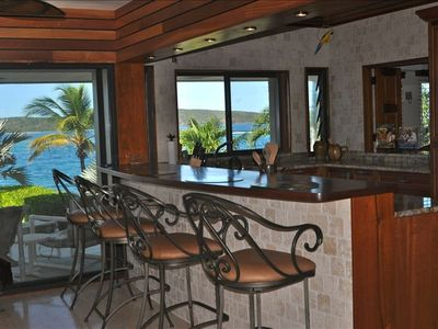 Kitchen bar area with patio access and  spectacular views and sea breezes