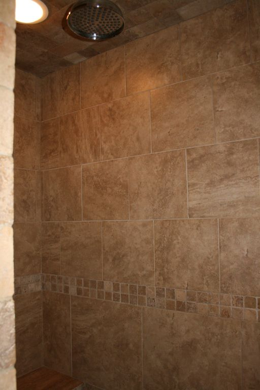 Master shower with options; your pick of regular shower head and/or rain.