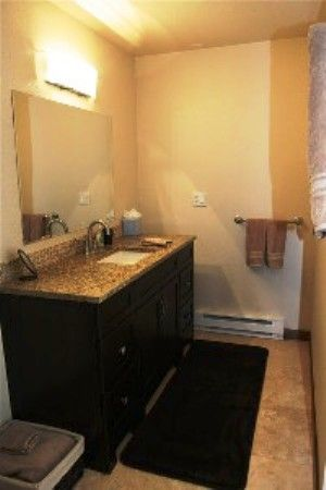 Bathroom is separate from living space with new towels & bath mats