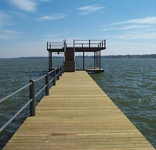 East facing, open water views from two story boat dock with huge party deck!