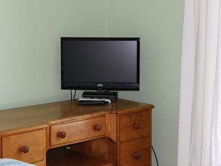 Cape Charles house photo - TV and DVD player for green bedroom