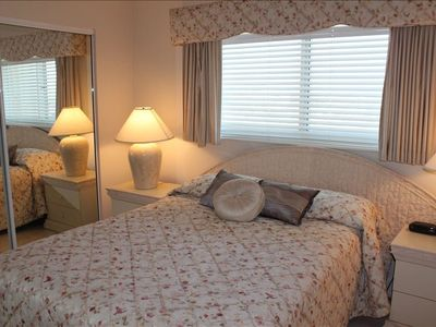 Custom drapes and bedspread on queen beds, flatscreen tvs and private baths