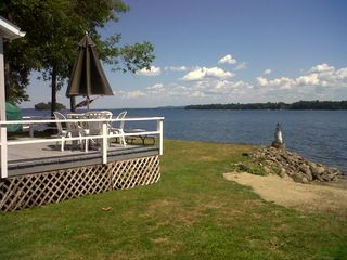 Mere steps from the deck to the sandy beach! - South Hero cottage vacation rental photo