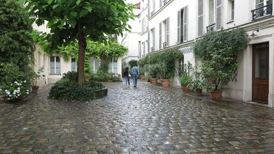 The courtyard from the entry on Rue de Jarente - apartment is at right rear