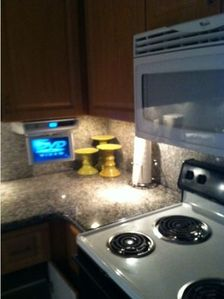 kitchen TV built in under cabinet, granite counter top, micro & new range