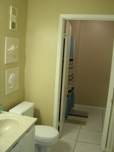 Jack and Jill style bathrooms are separated for privacy.