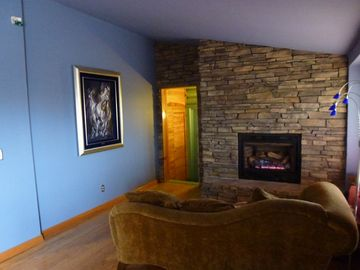 First floor sitting room with gas fireplace and adjacent to the kitchen.