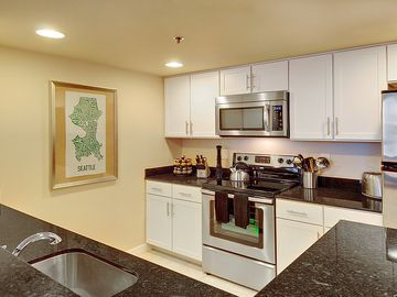 Kitchen - Newly remodeled with granite countertops, tile floors and stainless st