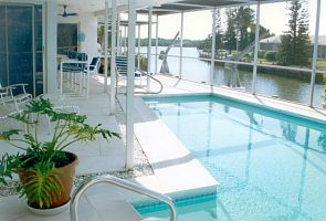 Vacation Homes in Marco Island house rental - Screened pool/spa and patio dining, outside bar