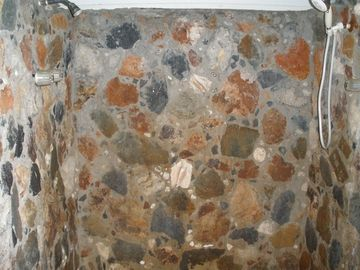 Shared native stone shower
